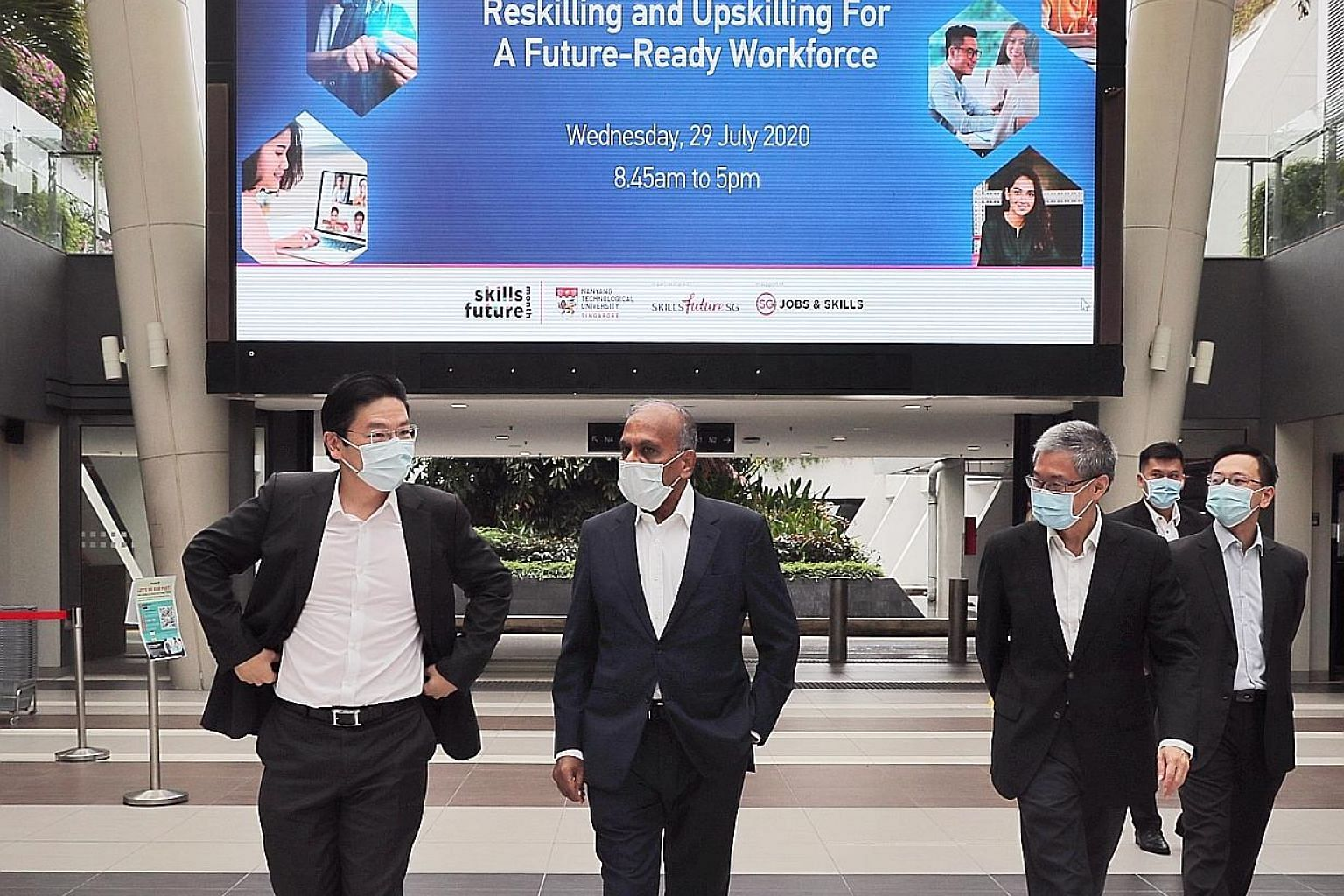 (From left) Education Minister Lawrence Wong, Nanyang Technological University (NTU) president Subra Suresh, NTU deputy president and provost Ling San, and other guests arriving at SkillsFuture@NTU yesterday. ST PHOTO: GAVIN FOO