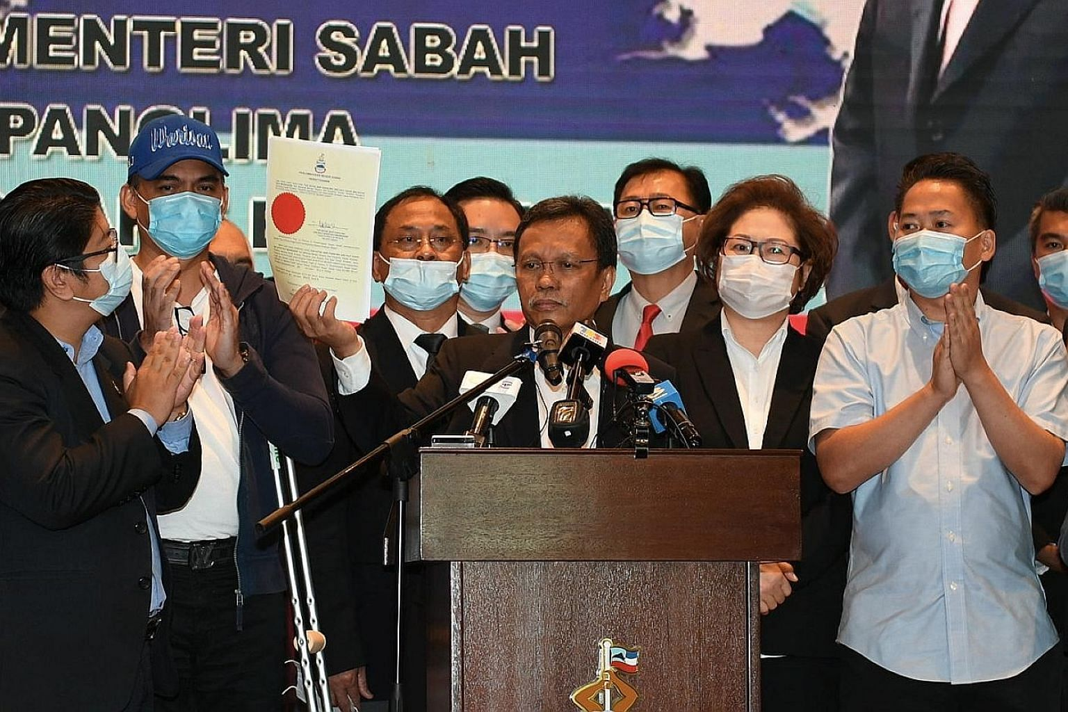 Sabah Chief Minister Shafie Apdal holding up the letter of dissolution of the state legislative assembly yesterday. An election has to take place within 60 days of the dissolution, and Datuk Seri Shafie will remain the caretaker chief until the polls