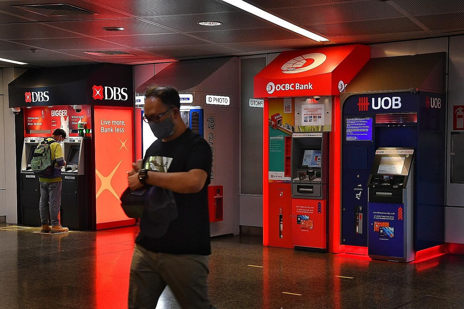DBS, OCBC and UOB account for nearly 40 per cent of the Straits Times Index, which dropped as much as 2.4 per cent before ending down 1.7 per cent yesterday. ST PHOTO: CHONG JUN LIANG