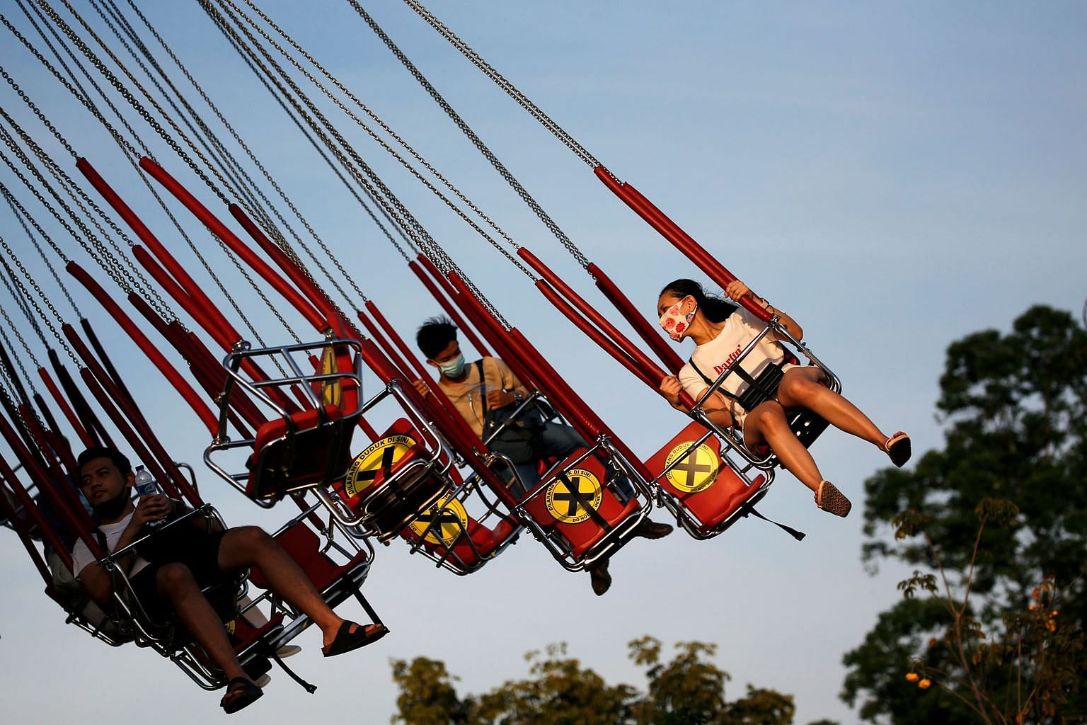 People at Dunia Fantasi amusement park in Jakarta on Sunday. Cities and provinces across Indonesia have gradually eased restrictive measures imposed as part of partial lockdowns. PHOTO: REUTERS