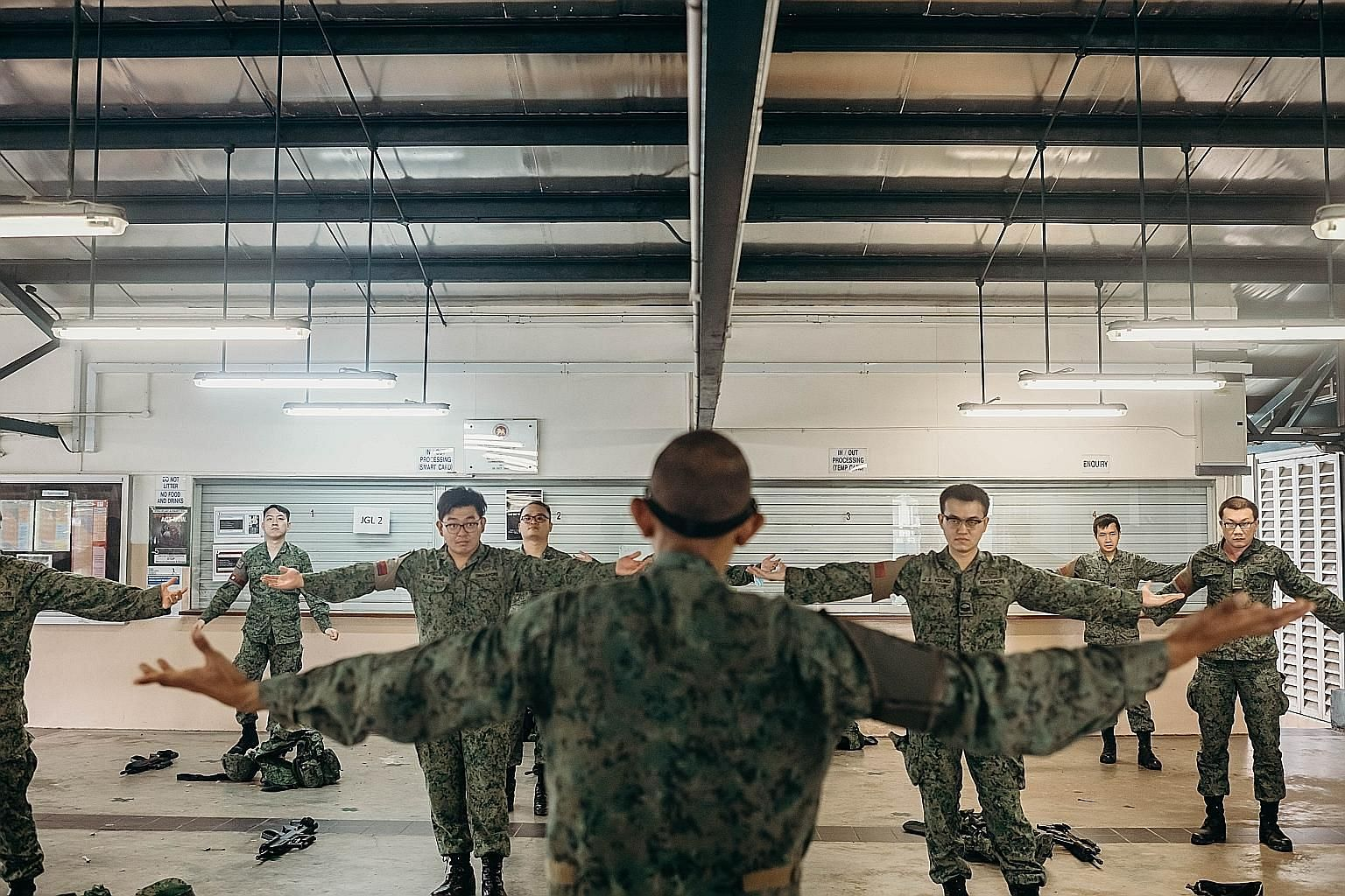 Operationally ready national servicemen from the 735th Battalion Singapore Guards taking part in pre-deployment training last month.