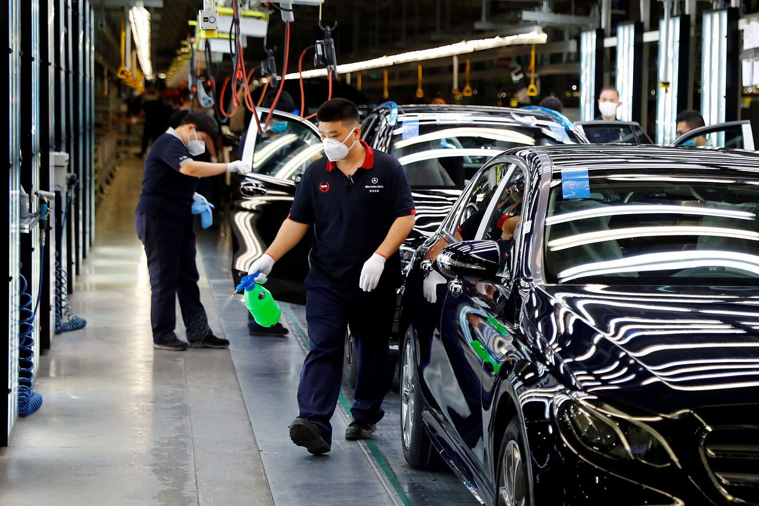 Employees at a plant of the Daimler-BAIC joint venture's Beijing Benz Automotive in Beijing in May. Despite better PMI readings, analysts caution that the recovery could stall amid rising global Covid-19 infections and as China's factories deal with