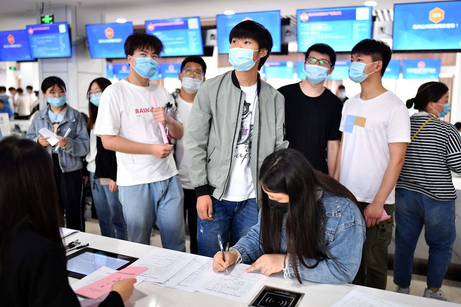 A job fair for college graduates in Bozhou city, in China's Anhui province. A UOB report says 19.3 per cent of new Chinese graduates are jobless. PHOTO: REUTERS