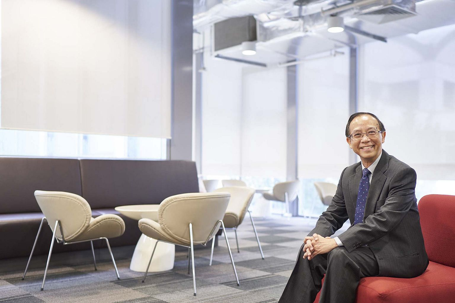 SUSS president Cheong Hee Kiat (above) said the university is in discussions with the Ministry of Education about a new campus, although its location has not been decided. It is now operating on rented premises (right) in Clementi.