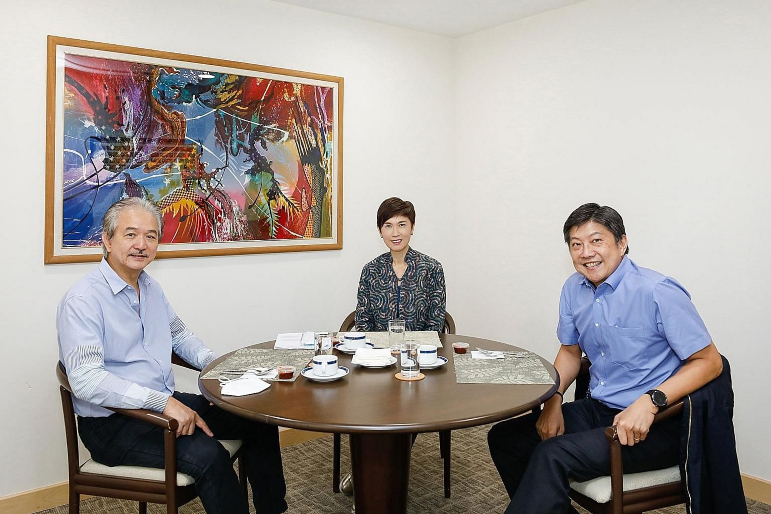 NTUC secretary-general Ng Chee Meng (right) at a meeting last week with Manpower Minister Josephine Teo and Singapore National Employers Federation president Robert Yap.