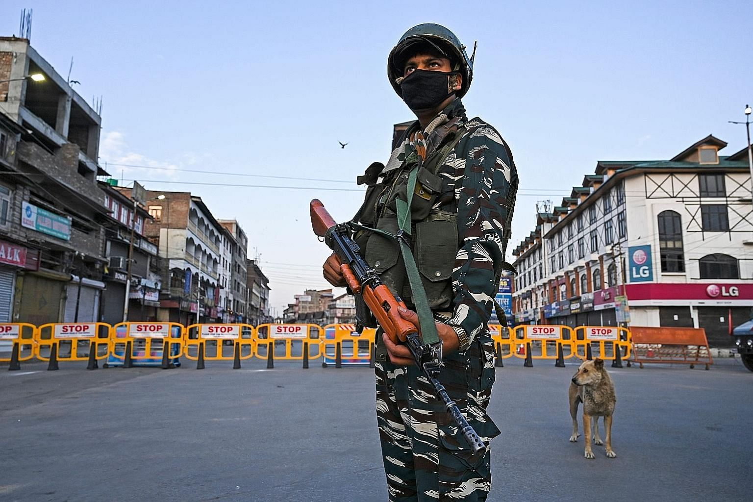 A soldier questioning a motorist at a checkpoint in Srinagar yesterday.