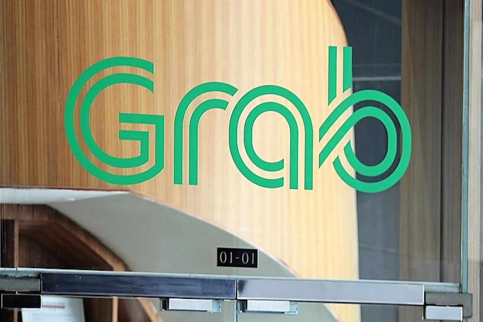 Grab's financial services arm is rolling out AutoInvest, which lets users invest sums as small as $1 while spending in Grab's ecosystem. ST PHOTO: KELVIN CHNG