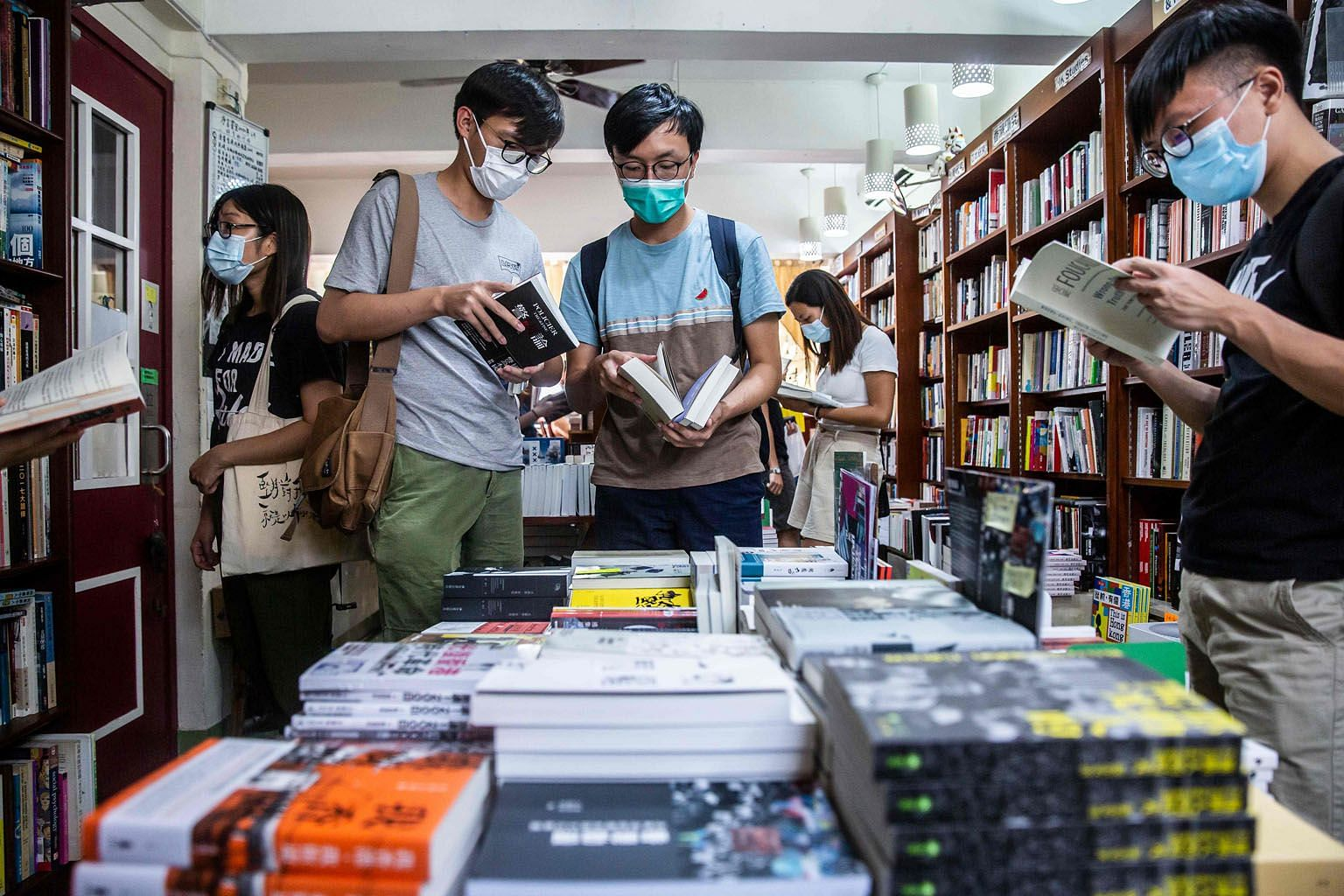 Customers browsing in a bookstore in Hong Kong last month. The city has long been a refuge for intellectuals, but that status is at risk of crumbling as Beijing's security legislation sends fresh jitters through a publishing industry already wary of