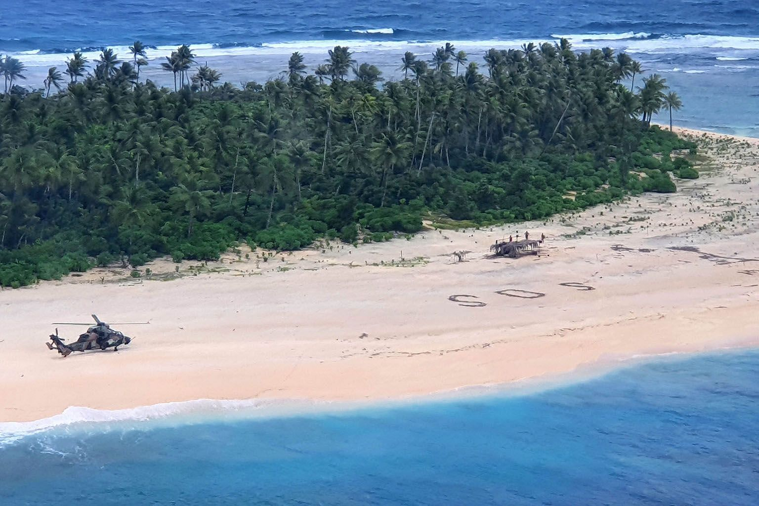 Three Micronesian sailors stranded on a remote Pacific island drew a giant SOS message in the sand to attract the attention of rescuers, who found them three days after they went missing at sea. Australian and United States aircraft located the men o