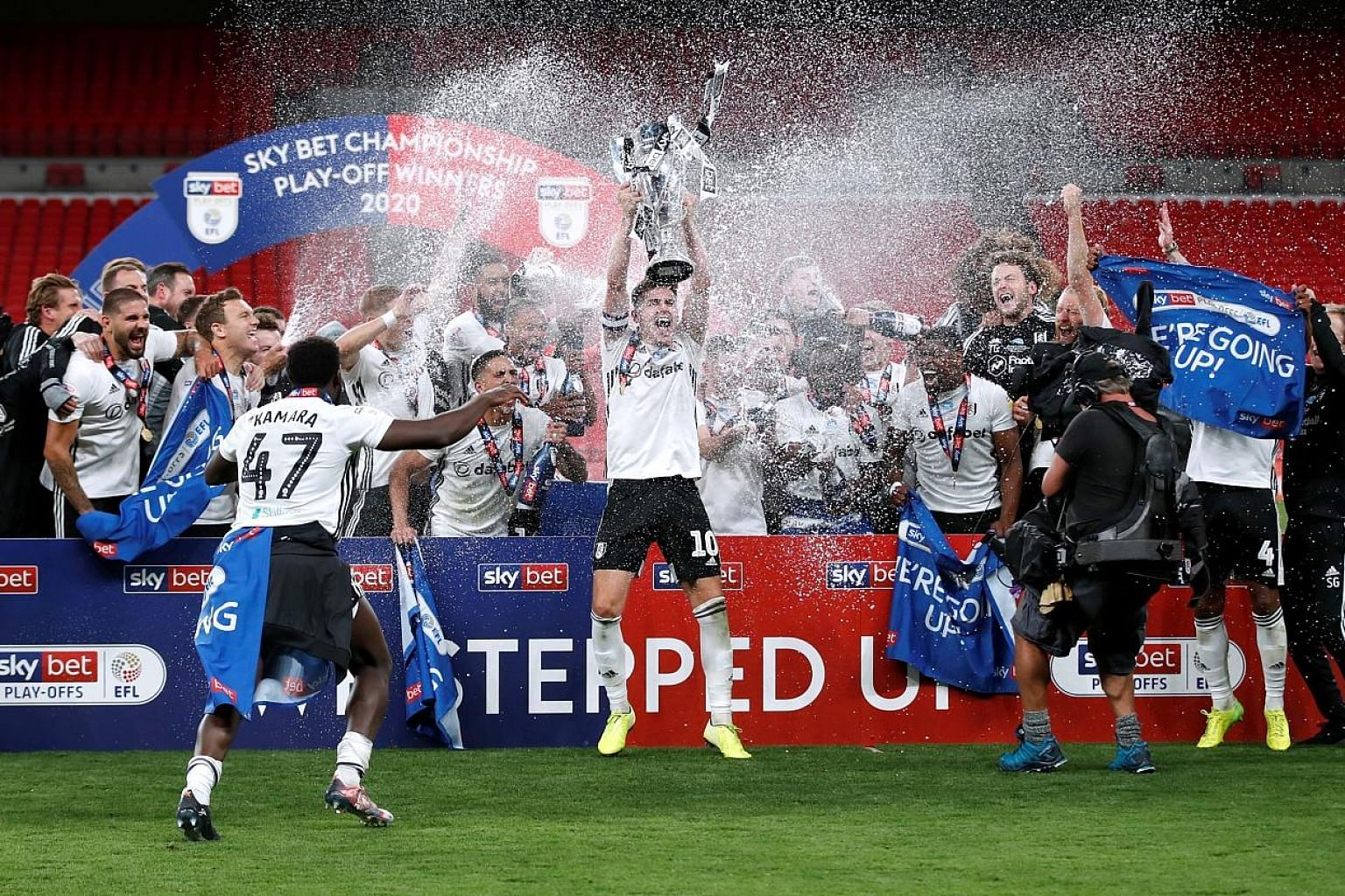 Fulham celebrating after beating London rivals Brentford 2-1 in the Championship play-off final behind closed doors at Wembley on Tuesday.