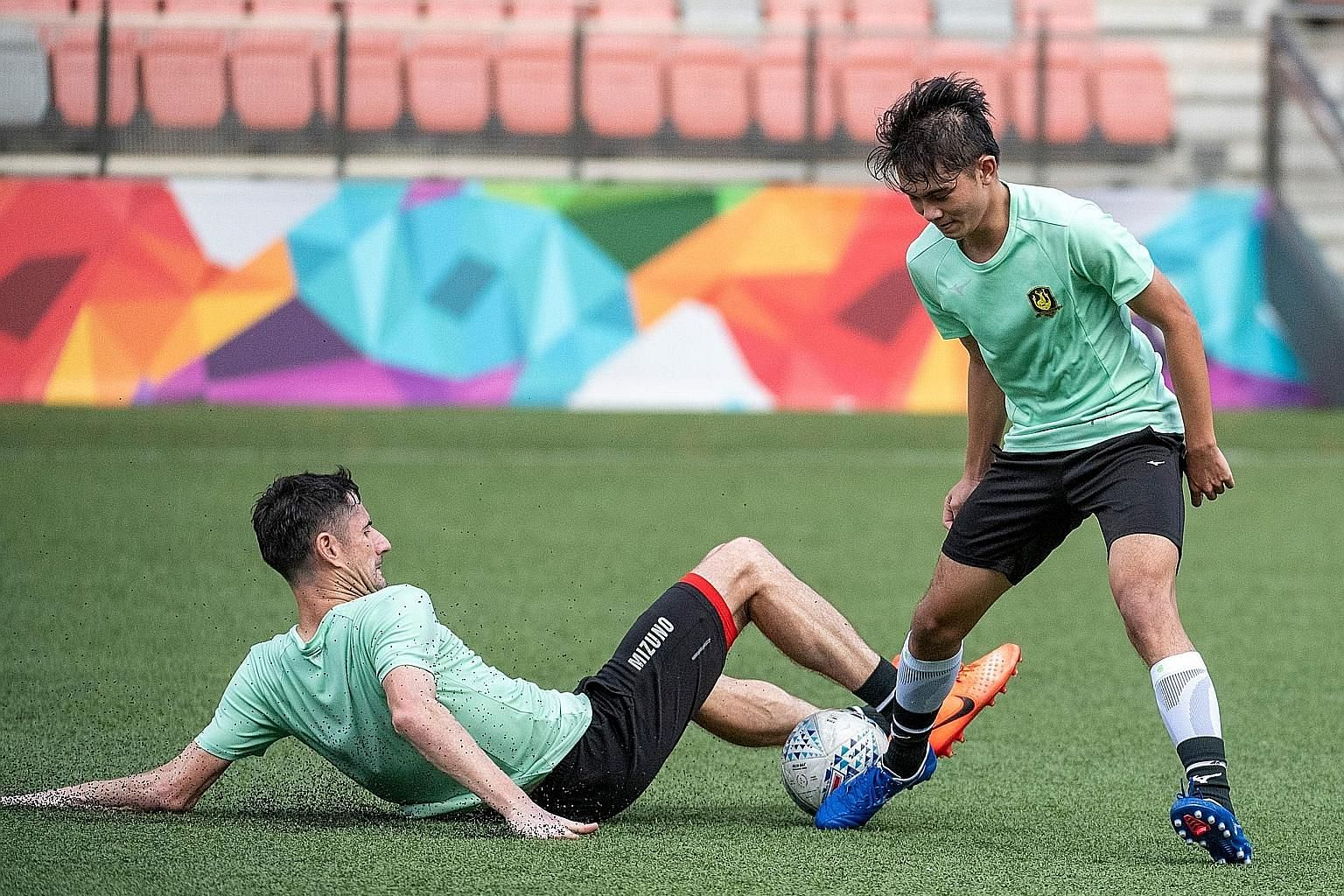 Tampines Rovers' veteran defender Daniel Bennett tackling forward Danish Siregar during training at Our Tampines Hub last month. The Singapore Premier League leaders are taking gradual steps in preparing for the possible restart of play soon, with th