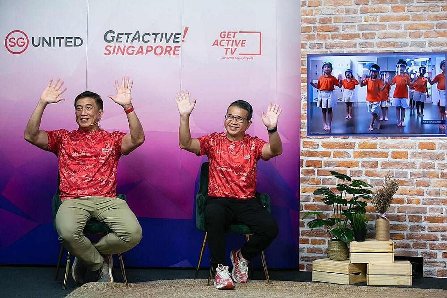 Minister for Culture, Community and Youth Edwin Tong (right) and SportSG CEO Lim Teck Yin waving to pre-schoolers yesterday.