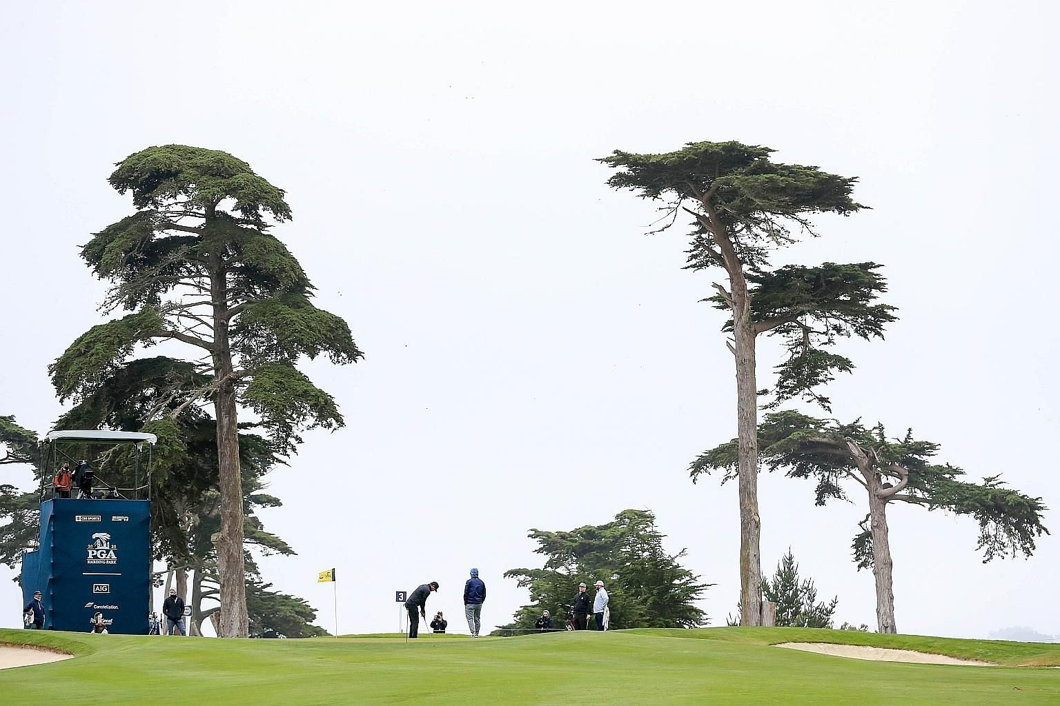 """Brooks Koepka putts on the third green during a practice round ahead of the PGA Championship at TPC Harding Park. The American calls it a """"big boy course"""" with its tight fairways lined by majestic cypress trees."""