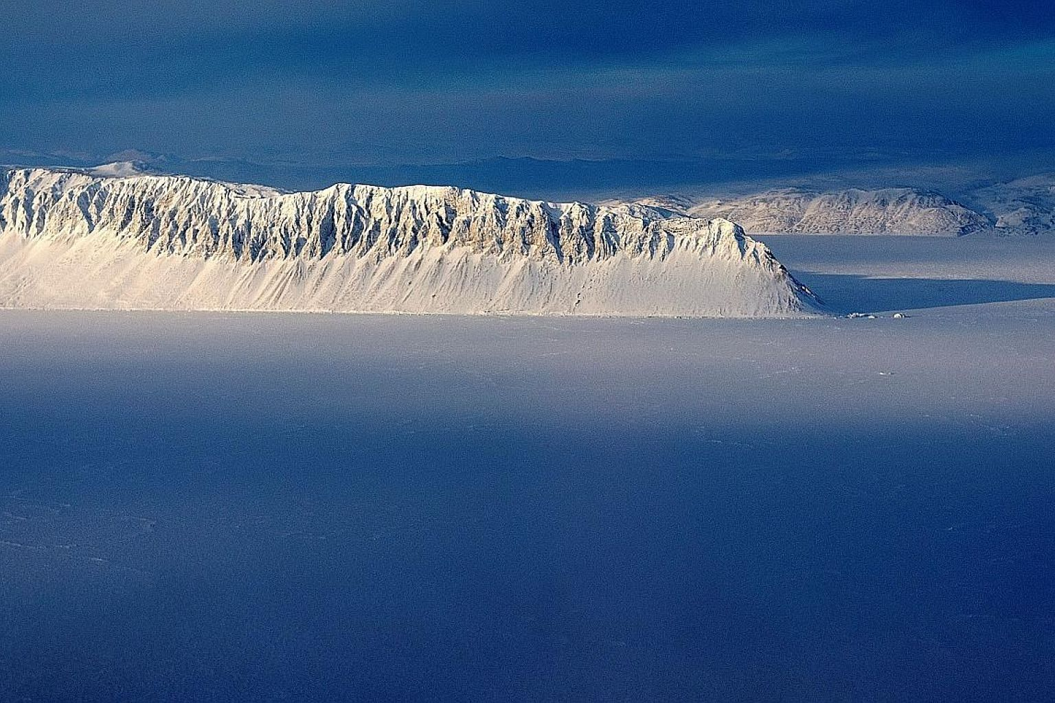 """Eureka Sound on Ellesmere Island as seen in a Nasa Operation IceBridge survey picture taken on March 25, 2014. The Milne Ice Shelf, at the fringe of Ellesmere Island, has collapsed. """"Above-normal air temperatures, offshore winds and open water in fro"""
