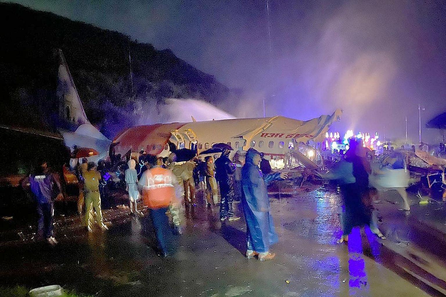The wreckage of the Air India Express plane that split into two after it overshot the runway at the Calicut International Airport and plunged into a valley in India's southern state of Kerala last night. The Boeing 737 jet was carrying 190 people on