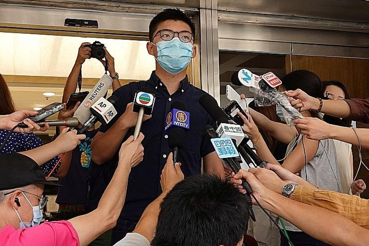 Activist Joshua Wong speaking to the media yesterday at the High Court where he lodged a judicial review over his disqualification following the 2019 district council elections. PHOTO: REUTERS