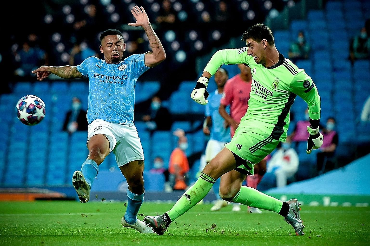 Real Madrid's goalkeeper Thibaut Courtois clearing the ball in time from Manchester City's Gabriel Jesus in their Champions League round-of-16 second leg at the Etihad Stadium on Friday. But Courtois could not stop two strikes by Jesus and Raheem Ste