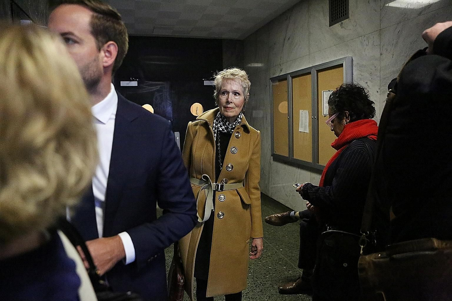 Ms E. Jean Carroll arriving at a Manhattan court in March. Ms Carroll, who sued US President Donald Trump for defamation in November, says he attacked her in a department store dressing room in Manhattan in the 1990s.