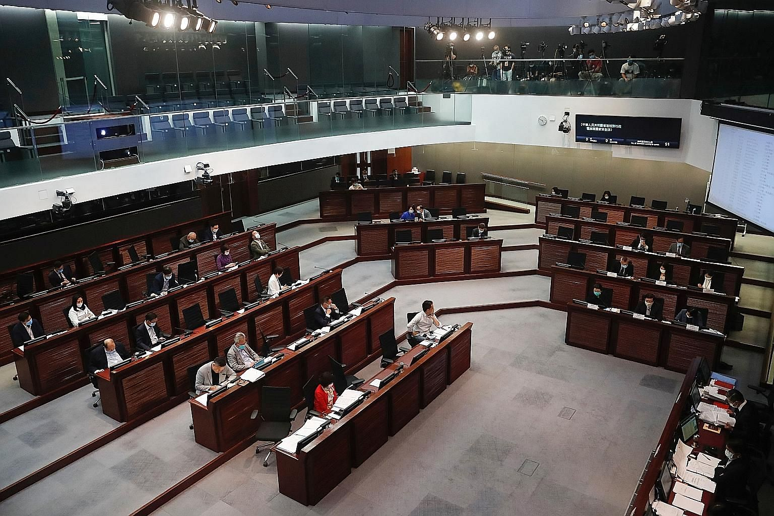A Legislative Council meeting to debate the national security law in Hong Kong last month. The top decision-making body of China's Parliament convened a four-day session yesterday to discuss whether to extend the term of the current Hong Kong legisla