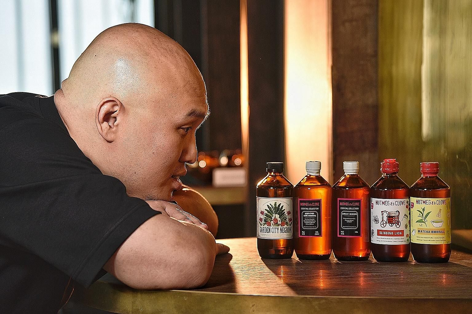 Nutmeg & Clove co-founder Colin Chia with the bar's bottled cocktails, which it has been selling since the start of its business in 2014. ST PHOTO: DESMOND WEE