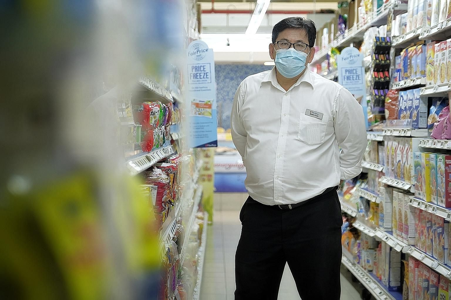FairPrice branch manager Mohamed Amin manages a team of over 50 people at the Block 135 Jurong Gateway Road outlet. The team has put in longer hours to serve a larger volume of customers amid the pandemic.