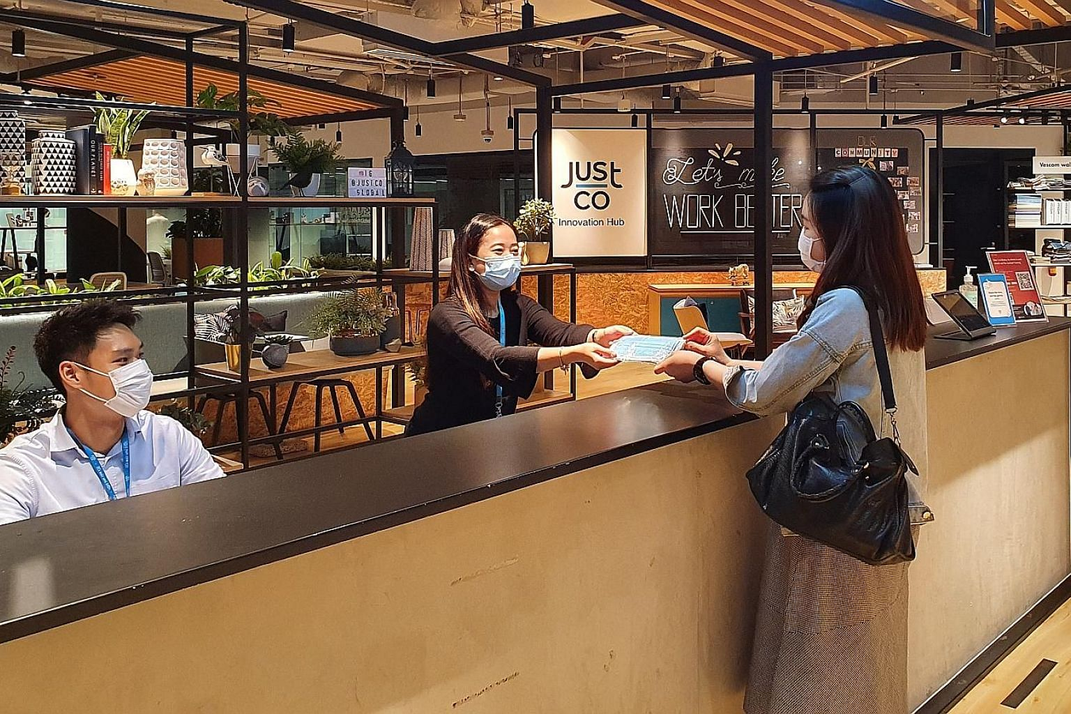 The JustCo co-working space at Marina Square. The local operator, which has 17 co-working spaces here, is opening two new centres - at OCBC Centre East and The Centrepoint this month and in October, respectively. The launch was delayed due to the pan