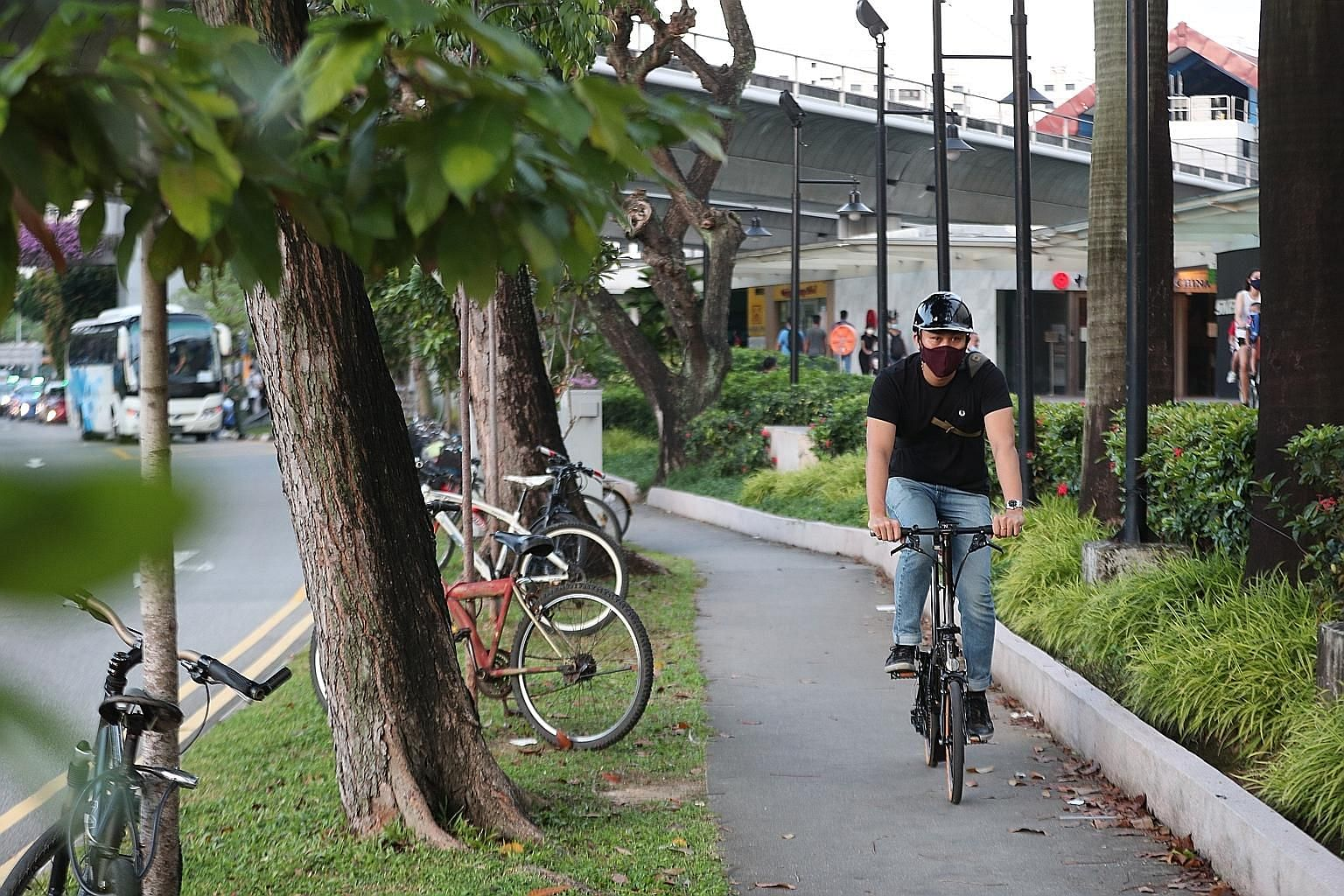 Among the many people in Singapore who are now using the bicycle as a mode of transport are (from top) warehouse supervisor Bernard Hii, who pedals 17km to his workplace; biotech engineer Xavier Lum, who cycles for part of his commute; and regional s