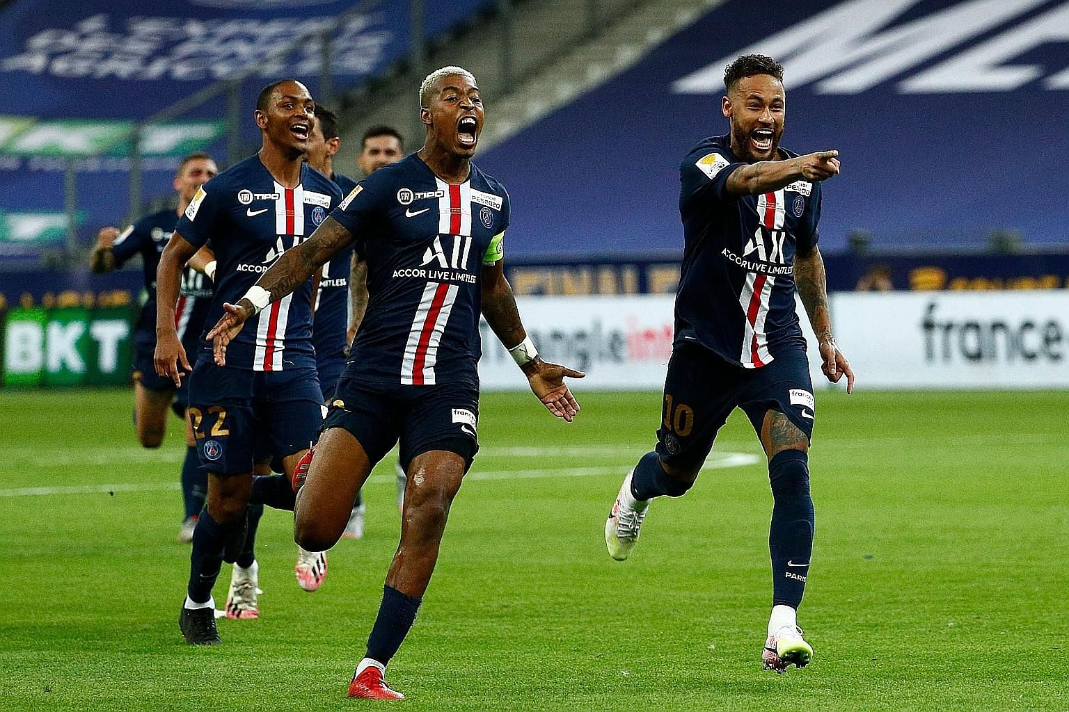 PSG forward Neymar (right) and teammates celebrating their French League Cup final win over Lyon at the Stade de France last month.