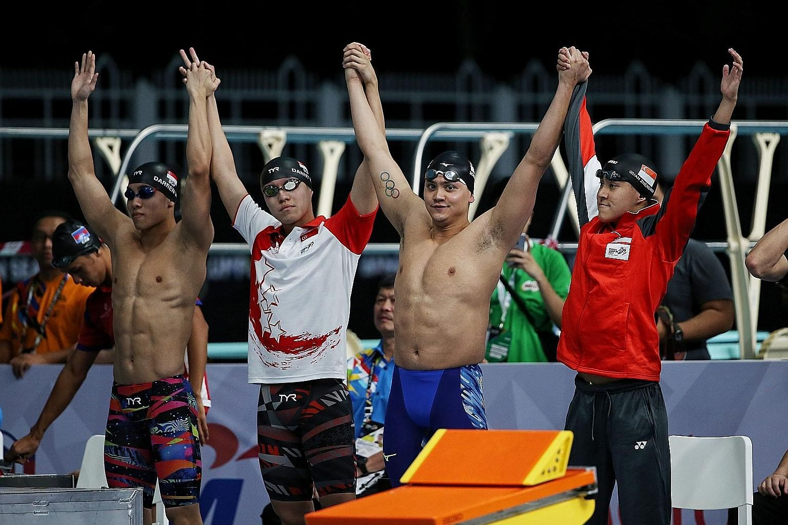 "Olympic champion Joseph Schooling (second from right) and Quah Zheng Wen (extreme right) can continue to train ""unhindered"" for the Tokyo Games after Mindef granted the pair extensions to their national service deferments."