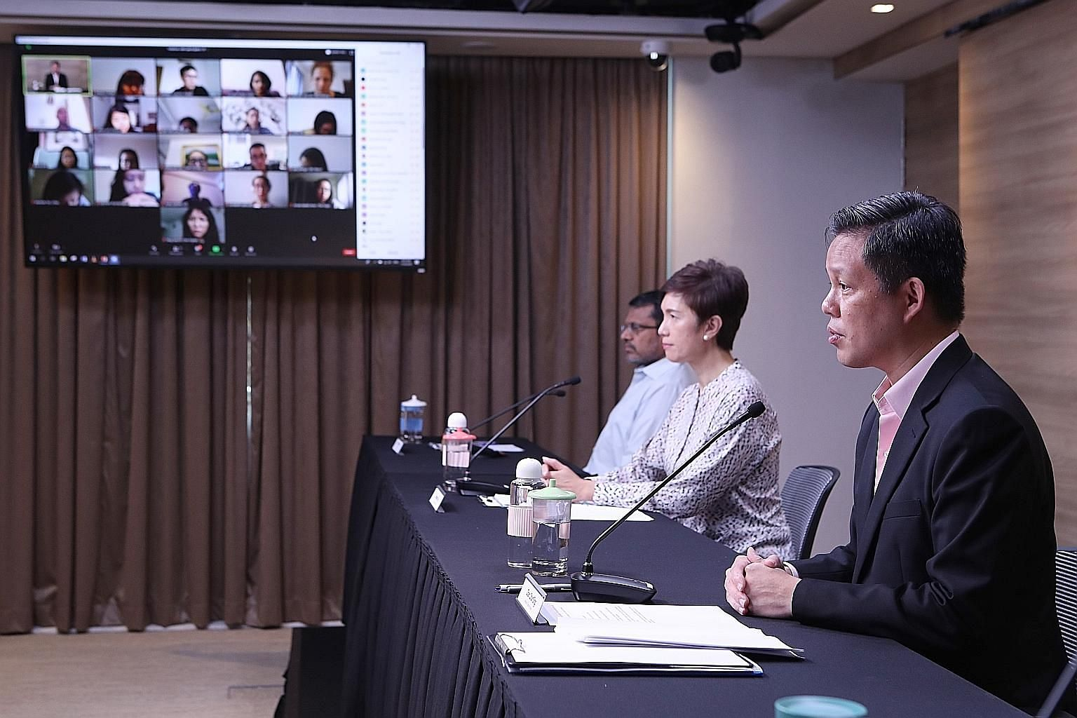 (From right) Trade and Industry Minister Chan Chun Sing, Manpower Minister Josephine Teo and Monetary Authority of Singapore managing director Ravi Menon at yesterday's press conference, where it was announced that Singapore's economy contracted 6.7