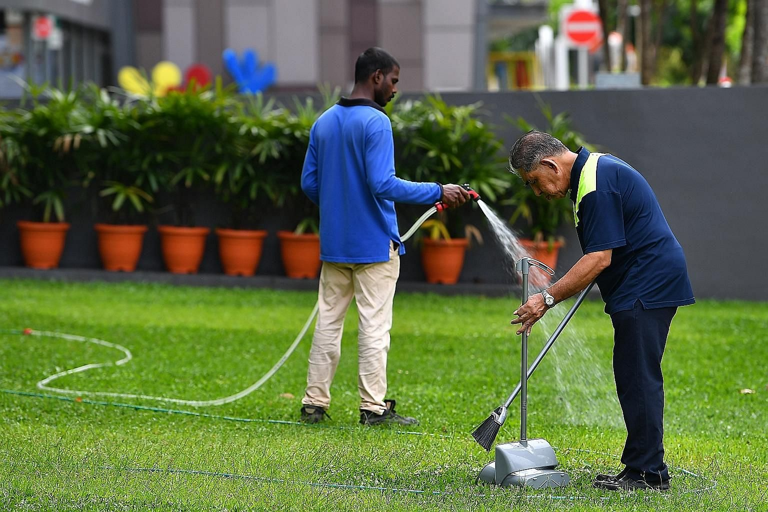 The writer says one should examine the performance of the Progressive Wage Model (PWM) using employment data from the security, cleaning and landscaping sectors, where the PWM has raised the minimum wage.
