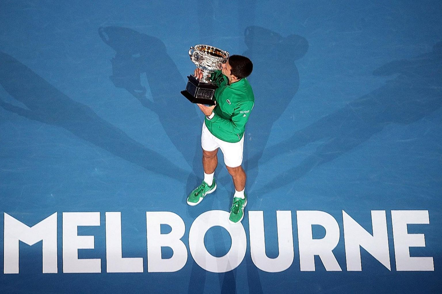 Serbia's Novak Djokovic kissing the trophy after winning the Australian Open final against Dominic Thiem of Austria in February for a 17th Grand Slam title.