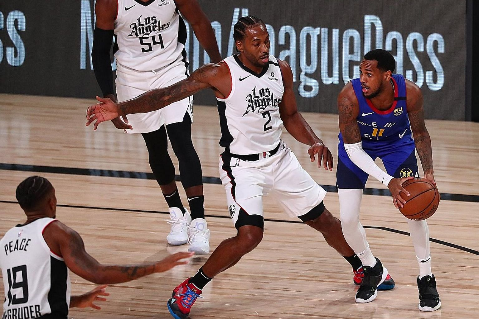 Denver Nuggets guard Monte Morris (extreme right) comes up against LA Clippers forward Kawhi Leonard at the AdventHealth Arena on Wednesday. The Clippers secured the second seed in the Western Conference with their 124-111 win over the Nuggets.