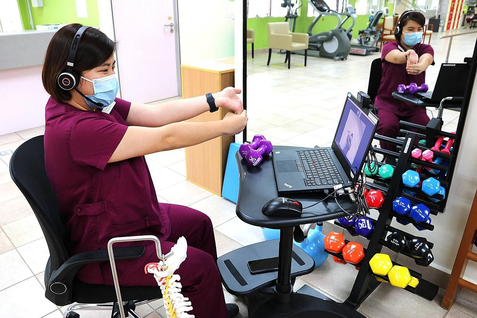 Above: Khoo Teck Puat Hospital's senior physiotherapist Jonathan Loh demonstrating an elbow-extension strengthening exercise using a light weight. Below: Tan Tock Seng Hospital's speech therapist Maranda Lim conducting language therapy with a patient