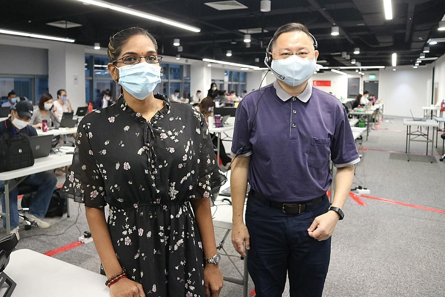 Ms J. P. Thanumadhya, 27, and Mr Zim Loo Poh Thye, 53, started work as call centre operators in July under Certis' initiative, Breaking Barriers.