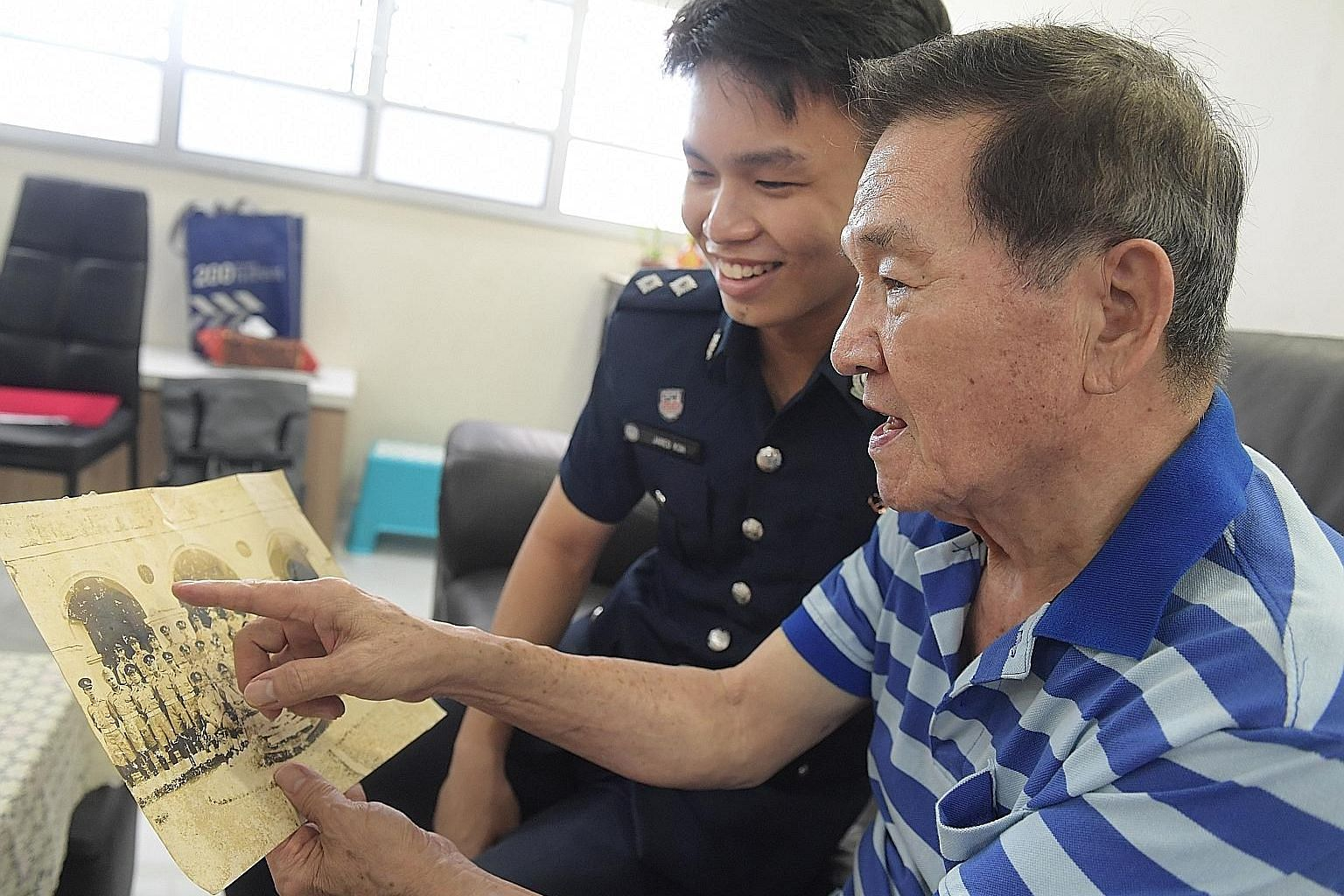 Scholarship recipient Jared Koh was inspired to join the police force by his grandfather, Mr Tan Hang Meng, who was a former policeman. Mr Koh grew up listening to his grandfather's police yarns. ST PHOTO: ALPHONSUS CHERN