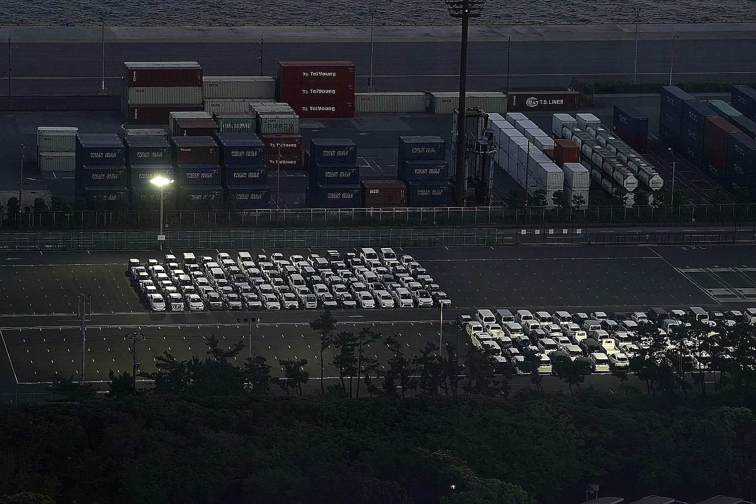 Vehicles bound for shipment near Chiba Port in Japan last Saturday. Data on Monday showed Japan was hit by its biggest economic slump on record in the second quarter as the pandemic crushed demand for cars and other exports, knocking the size of real
