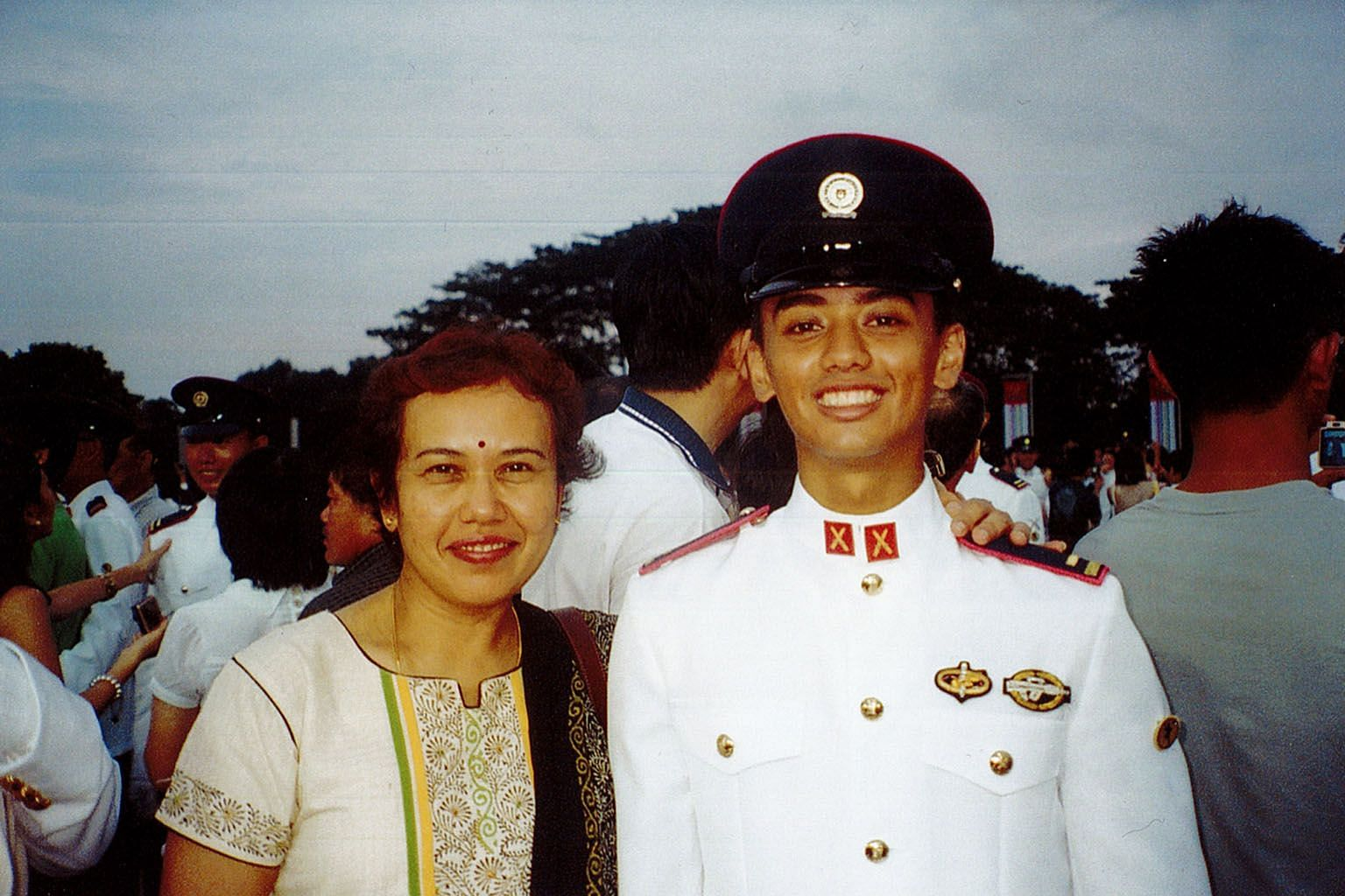 The writer, who made the decision to return to Singapore to serve national service, and his mother Selvarani Bannirchelvam, now 60, at his Officer Cadet School commissioning parade at Safti Military Institute in 2009.