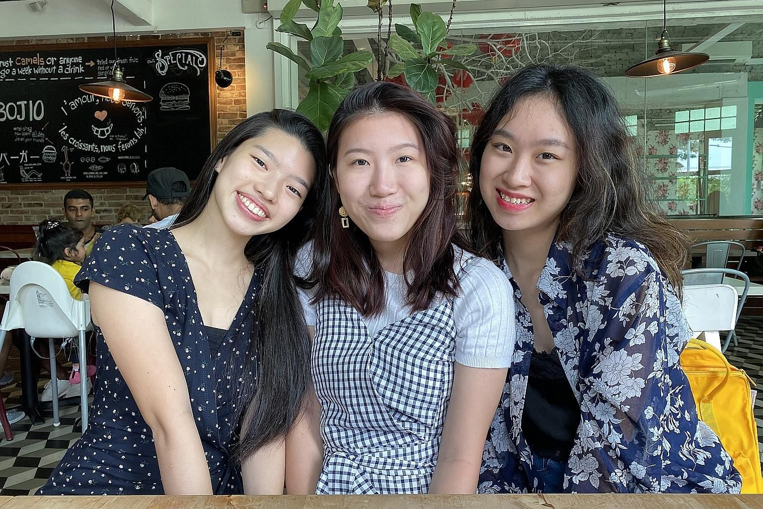 Ms Rachel Han (left) and Ms Rachel Lee (right) are founders of Package Pals, an initiative that collects single-use packaging and distributes it to retailers for reuse. With them is core team member Puan Xin.