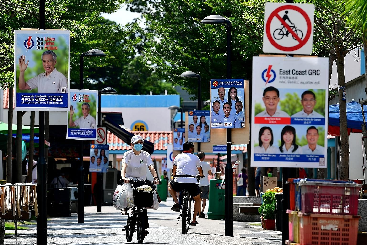 People's Action Party and Workers' Party campaign posters in New Upper Changi Road in East Coast GRC before the July 10 general election. Analysts reckon that it is too soon to say if anything has fundamentally changed about the way voters approach t