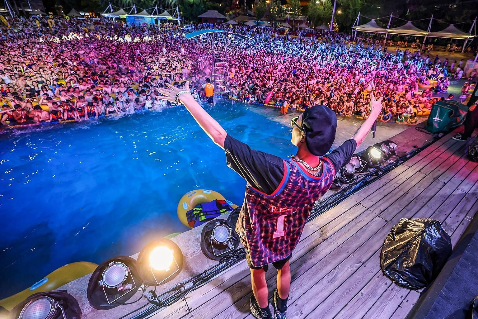 Thousands of partygoers watching a show as they cool off at a water park in Wuhan last weekend. No one seemed to be wearing face masks. Since mid-May, there have been no new domestically transmitted cases officially reported in Hubei province, where