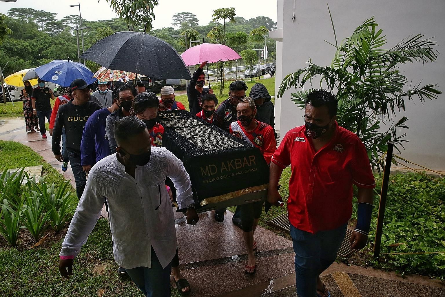Friends and relatives carrying the body of Putera Muhammad Indra Shazrine Suzaini to his family in Yishun yesterday. Rescue divers had found the teenager 15m from the shore at Changi Beach Park last Saturday. He was later pronounced dead at the scene