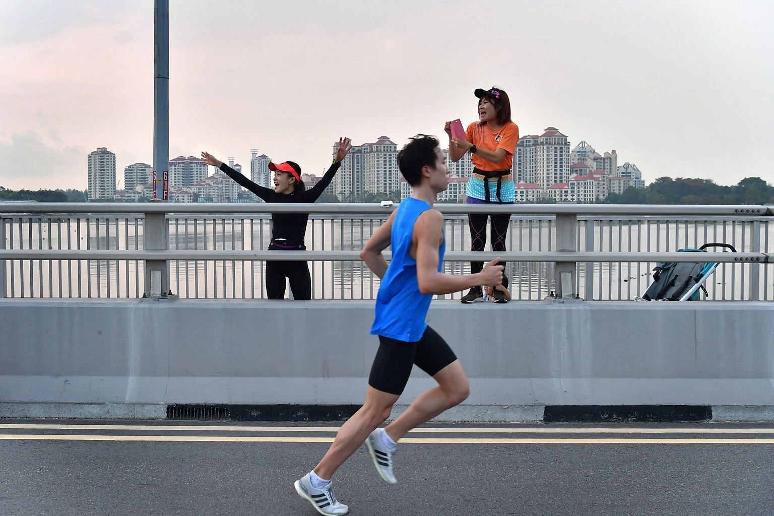 Supporters cheering ST Run participants on the Merdeka Bridge last September. To mark this newspaper's 175th anniversary, there will be two categories at The Straits Times Virtual Run - 17.5km and 175km.
