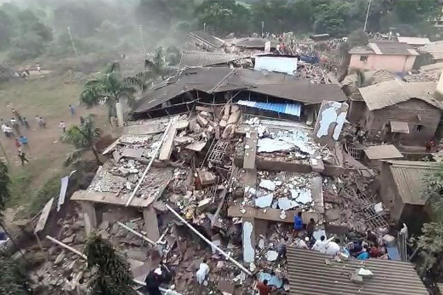 The five-storey building caved in yesterday. The authorities said 28 people were pulled out by rescue teams amid heavy monsoon rain. The number of dead is yet to be ascertained.