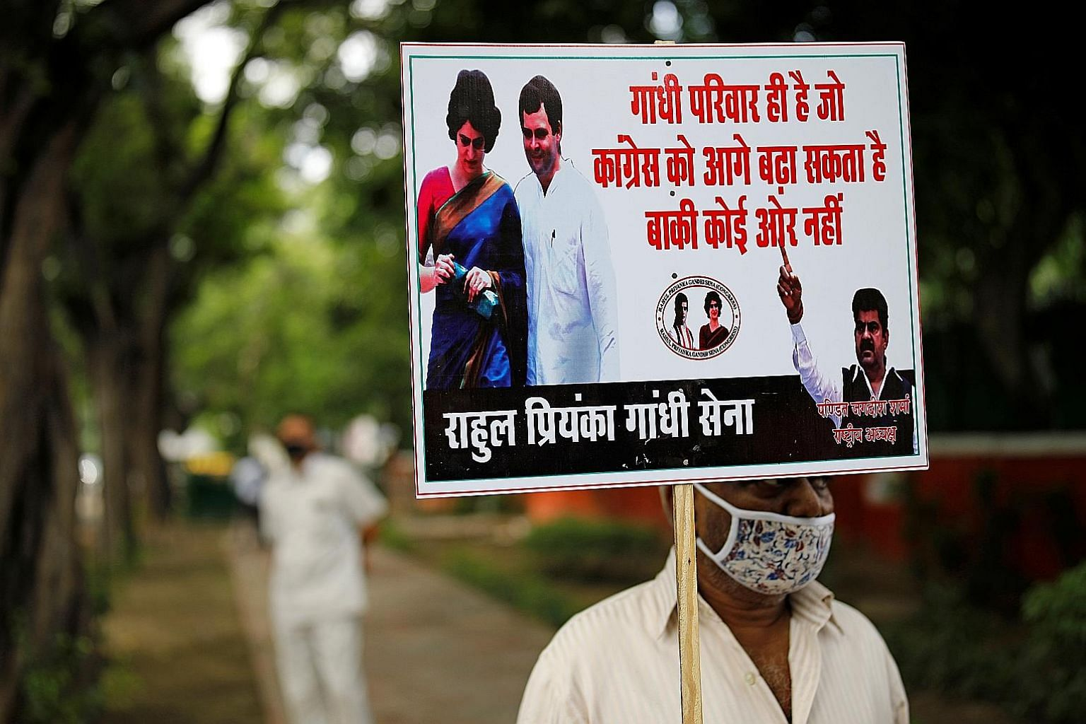 A protester at a rally to demand that the Congress party elect its leader from the Nehru-Gandhi family, outside the party's headquarters in New Delhi yesterday. Congress' interim president Sonia Gandhi had wanted to step down following the release of