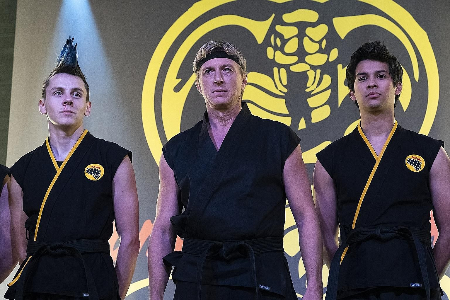 Documentary The Speed Cubers follows the two best Rubik's Cube speedcubers in the world - Feliks Zemdegs (far left) and Max Park (left). In Cobra Kai, William Zabka (centre) reprises his role as Johnny Lawrence, who teaches a new generation of karate