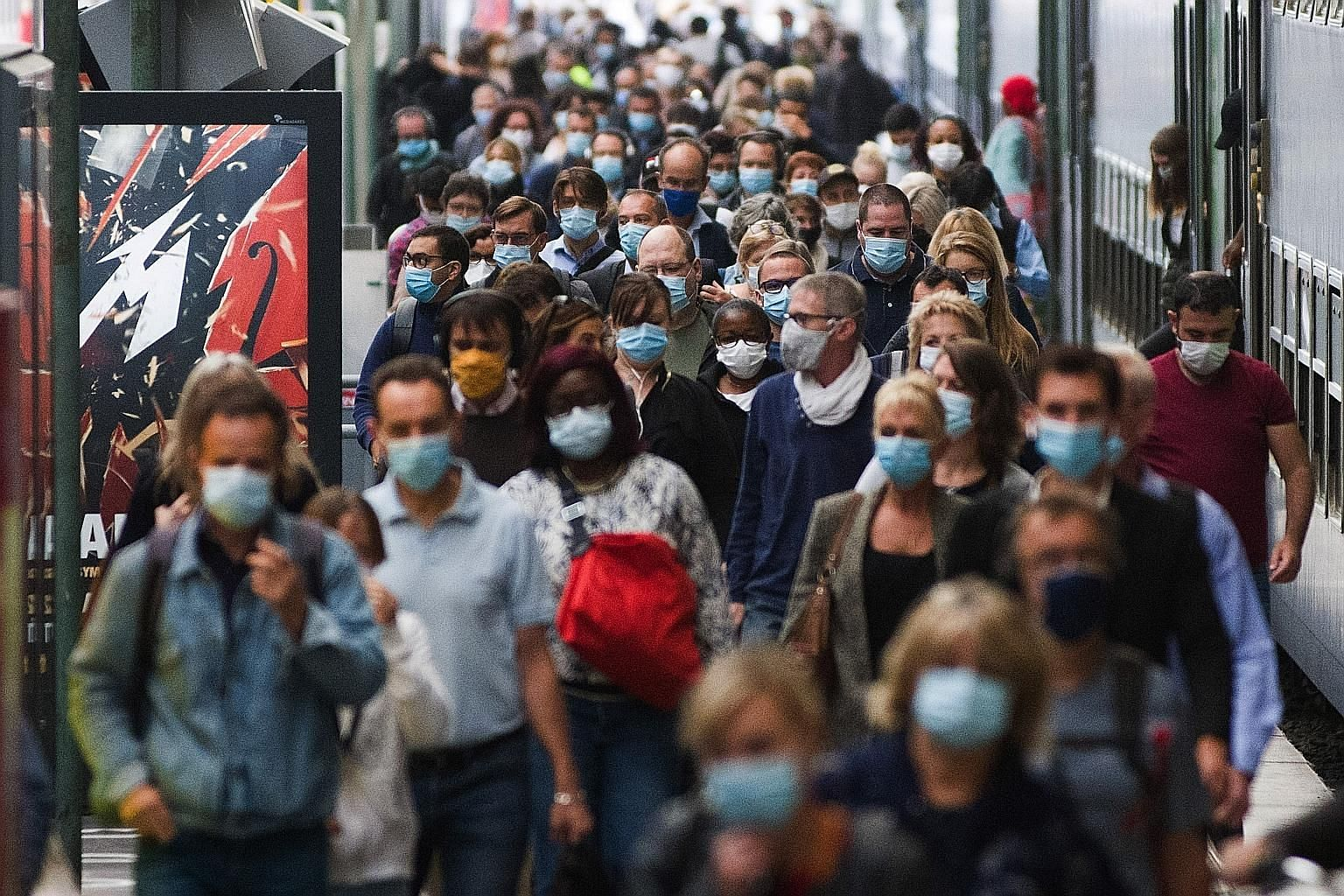 Commuters at Gare Du Nord railway station in Paris yesterday. Europe's tourism industry reopened last month, and prime tourist destinations like France, Spain and Malta have recently reported higher Covid-19 infection rates than countries like Britai
