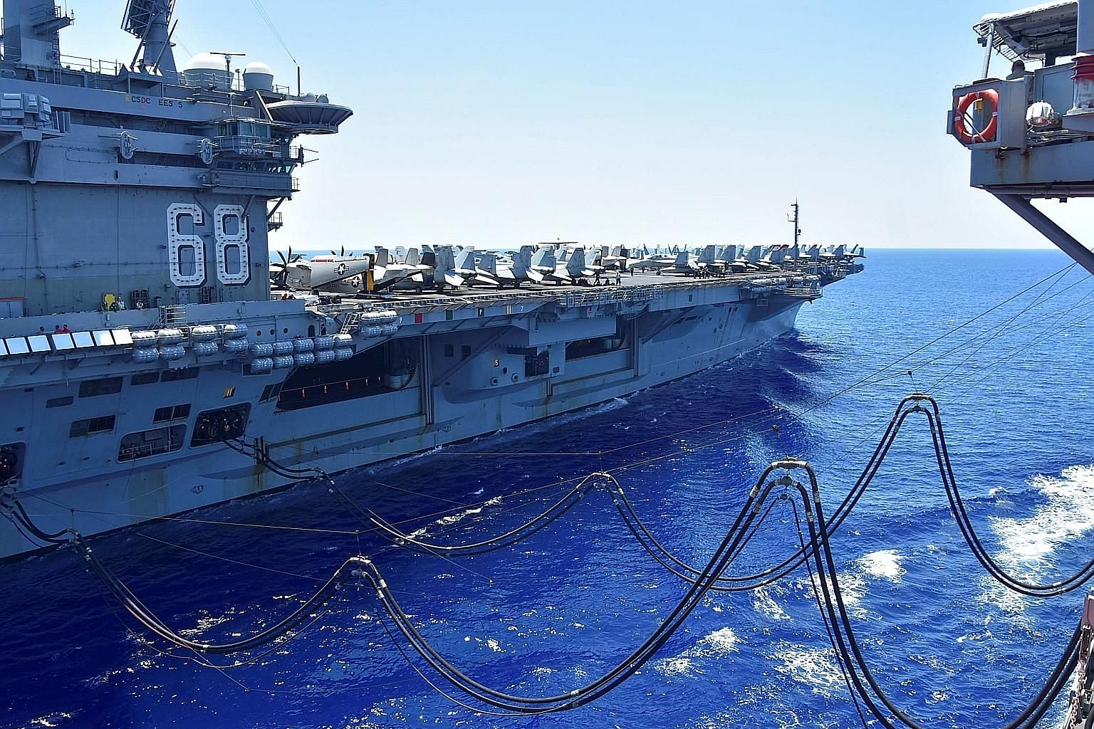 US Navy aircraft carrier USS Nimitz being refuelled in the South China Sea last month. The US considers Chinese claims to the waters enclosed by the nine-dash line in a Chinese map to be illegal, while China asserts that its claims are consistent wit