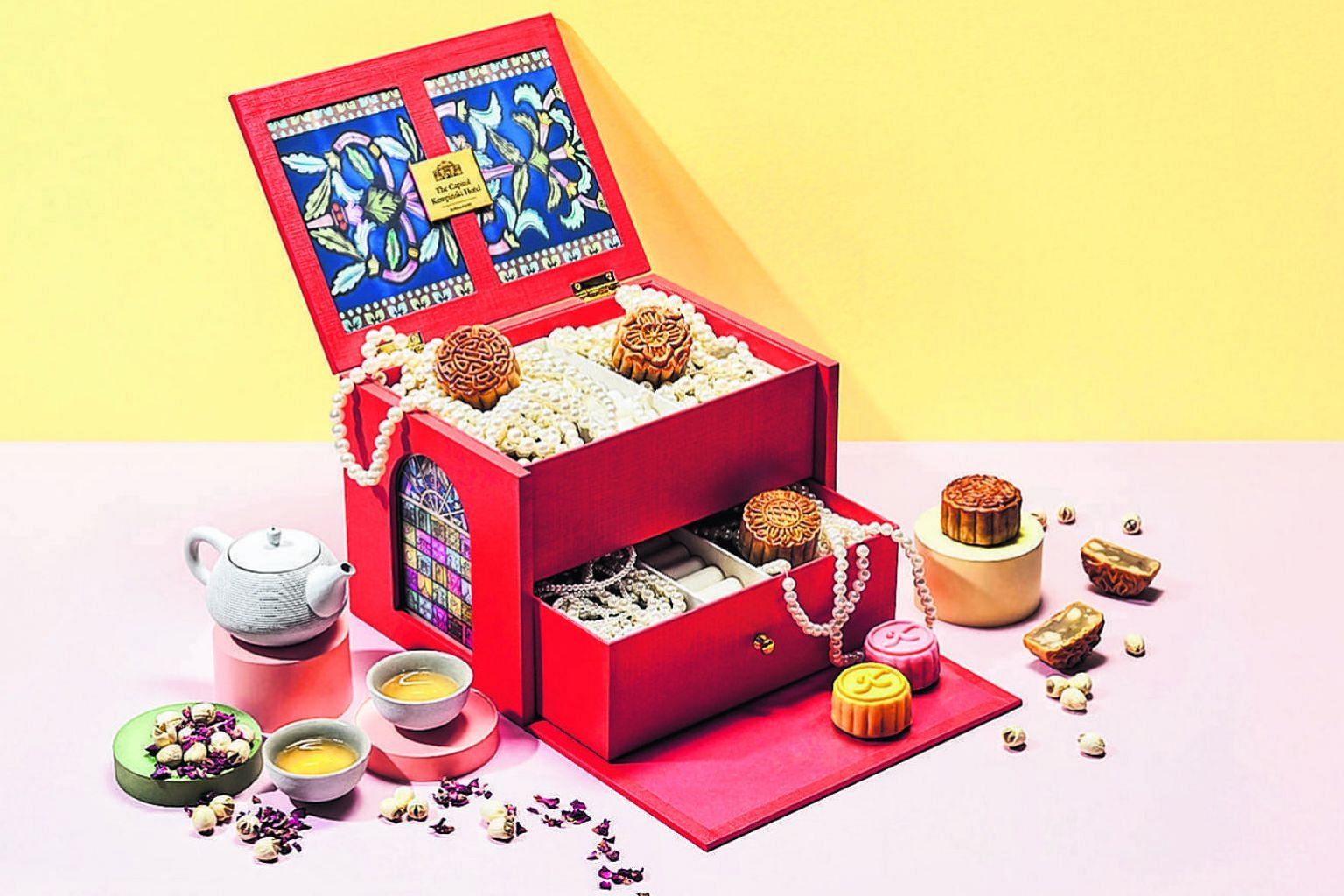 Above: Now Bakery's Shanghai mooncake filled with homemade sambal dry shrimp. Right: The Capitol Kempinski Hotel Singapore's mini mooncakes, presented in a jewellery box, with a range of six snowskin and four baked offerings. SPH subscribers will hav