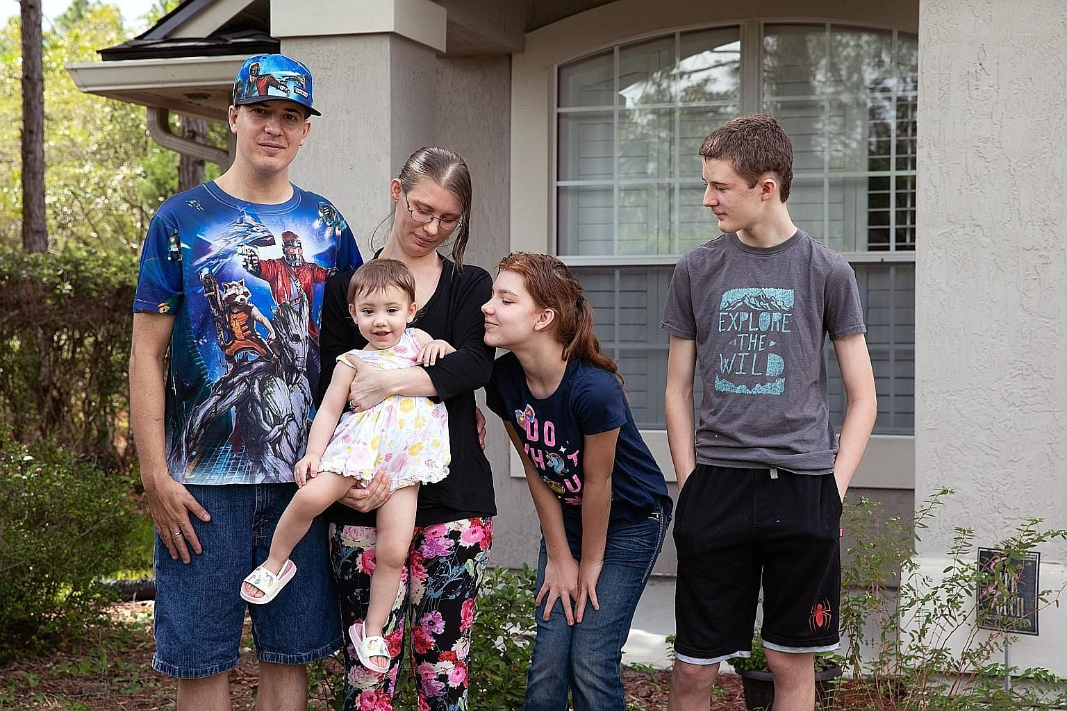 Mr Jared Strickland and his wife Karla Dennington with their children, Gracey, 17 months, Serenity, 12, and Riley, 14, at his parents' home in Florida where they live. After the pandemic hit, Mr Strickland was laid off. To keep food on the table, the